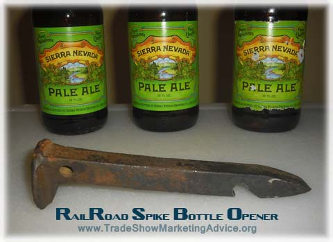 effective promotional product example - a railroad spike bottle opener